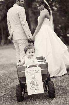 "I saw on ""Say Yes to The Dress"" -  I know, I know -- a couple who had their daughter in a wagon as they left their ceremony.  The sign on the wagon back said:  ""Just Married"" and the wagon was decked in the couple's wedding colors."