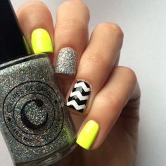 Neon chevron skittle nails.