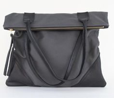 This leather and canvas beauty is an exclusive collaboration for www.mooreaseal.com! Plenty of room for your e-reader and other essentials.
