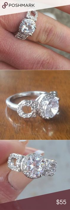 PLATINUM PLATED STERLING SILVER RING Stunning lab created 3 carat center stone. This ring is made with genuine Sterling Silver Plated with Platinum. Gorgeous. ALL MY JEWELRY IS BRAND NEW Jewelry Rings