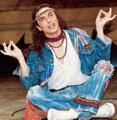 I would like to stop your scrolling to show you a picture of Johm Barrowman dressed as a hippie.