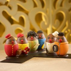 Shangri-La's first ever fashion collection made of chocolate, featuring six Easter eggs dressed in the iconic Shangri-La bellman, chef, life guard, housekeeping, engineer and The Line's service staff uniform. Shangri-La Hotel, Singapore