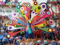 """A favorite Mexican folk art, alebrijes are small animal figurines that are hand-carved from the wood of the copal tree and intricately painted by hand, often with paints made from natural dyes such as pomegranate and huitlacoche (corn fungus), an ingredient you may not be familiar with until you go to Mexico. Translating to """"imaginary"""" or """"fantasy"""", the word alebrije is used to describe the whimsical style of the colorful painted creatures."""