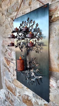 This listing is for a three dimensional tree of life metal wall hanging. It holds 6 flickering LED tea lights and one LED votive candle which are included. It is made from 11 gauge mild steel and can be clear coated over the sanded steel finish or tinted black with a clear coat. It measures 16 wide x 22 high x 5 deep. It can be hung by a leather strap which is included or by the 4 holes provided. The piece is plasma cut, hand formed and welded at our shop Bright Metal Creations.