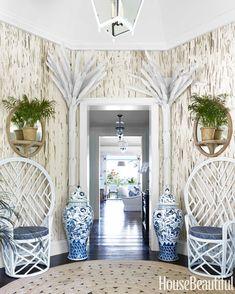 Niermann Weeks Tole Palm Trees are seen in this foyer designed by Amanda Lindroth. niermannweeks.com #NiermannWeeks