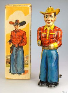 Technofix Shooting Cowboy. Mechanical tin toy from 50s/ebay