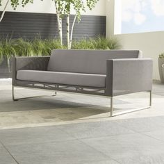 """Our urban style Dune lounge collection creates a modern """"indoor room"""" that lives outdoors.  The outdoor sofa's sleek outdoor-grade stainless steel frame is precisely mitered at the corners, welded, ground and buffed by hand to a seamless appearance, and upholstered in taupe synthetic mesh.  HandcraftedOutdoor-grade stainless steel frame upholstered in Batyline ® synthetic meshCushions are fade- and mildew-resistant Sunbrella acrylicPolyester wrapped foam cushion fillMade in China."""