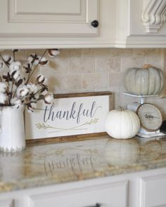 """This week the ladies hosting #OurGratefulHome want to see our #fallkitchen decor. I received this precious """"Thankful"""" sign in the mail yesterday from @charlie.and.ella, so I had to use it right away. It ended up on my kitchen counter with my vintage scale, a couple of pumpkins, and my cotton stems from @paintedfox1, and I love it! Yay for happy mail!"""