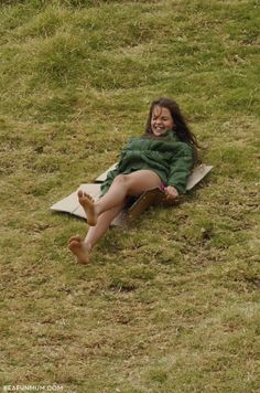 Grass Sledding - all you need is cardboard and a grassy hill.