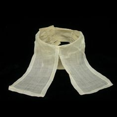 """Man's linen stock with short bands, English, 1780-1830. Stocks came in several styles. Stocks with hanging linen bands, called """"short bands,"""" were worn by clergymen, barristers, and academics. These stocks became symbolic of the learned professions."""