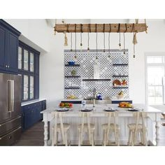 Beach house kitchen renovation inspiration. This re-imagined kitchen comes in shades of dark blue and whites to give the heart of the home a beach aesthetic. American Kitchen Design, Contemporary Kitchen Design, Kitchen Designs, Custom Kitchen Cabinets, Custom Kitchens, Kitchen Furniture, Beach House Kitchens, Home Kitchens, Interior Design Photography