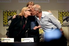 Harrison Ford Carrie Fisher Photos Photos - (L-R) Actors Carrie Fisher, Mark Hamill and Harrison Ford pose onstage at the Lucasfilm panel during Comic-Con International 2015 at the San Diego Convention Center on July 10, 2015 in San Diego, California. - Comic-Con International 2015 - Lucasfilm Panel
