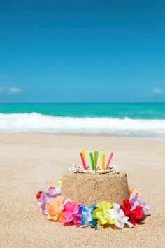 Subject A Sandcastle Birthday Cake With Candle And Lei On Happy GreetingsHappy Beach