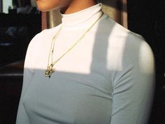 White turtleneck and gold jewlery