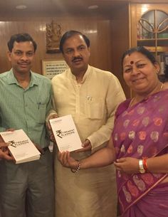 Mohapatra presenting a copy of his new book on Retirement Planning to Dr Mahesh Sharma