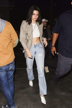 Strut your stuff: Kendall rocked her ripped jeans with a white cropped vest, showcasing her incredible figure