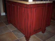 How to: Paint cabinets (secrets from a professional). All the tips and tricks you will ever need to know, straight from a faux painter. Red faux painted kitchen island, with black glazed finish. Theraggedwren.blogspot.com