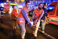 Ambulance workers evacuate victim from Bataclan theatre, Paris, Nov. 13