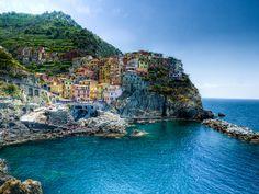 "The Cinque Terre is a portion of coast on the Italian Riviera.   ""The Five Lands"" is composed of five villages: Monterosso al Mare, Vernazza, Corniglia, Manarola, and Riomaggiore.  Here is a HDR panorama from Manarola."