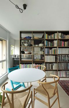 Amazing bookshelves as room divider. Via Apartment Therapy.