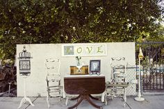 Antique rocking chairs & table for vintage wedding flair.