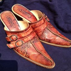 Gorgeous Vintage Italian Leather Mules These fabulous tooled Italian Leather Mules are gorgeous! A definite conversation piece and so comfy! These are in beautiful, gently used condition. The soles so some signs of wear, but there is tons of life still left in them. These will totally become your signature piece! By Donna Valenta in Riccione, Italy. Vintage Shoes Mules & Clogs