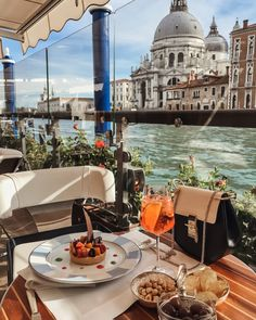 NEED TO GO THERE....ok I have been to Venice but never had a relaxing meal and lovely dessert and things right by the water like this.....And look at that sunlight...aaaah miss Italy!