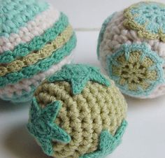 simple crocheted balls with crocheted embellishments - no pattern. gonna fill these with cat nip and let my kitties tear them apart.
