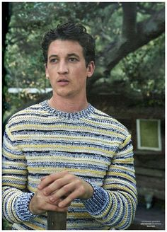 Miles Teller has a bright moment in a striped Dior Homme sweater.