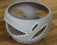 Bowl with cuts in it and designs around these cuts. maybe do ones with lines instead of circles like this one.