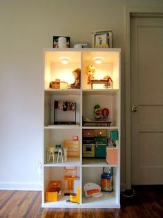 here is a good idea. a doll house from an ikea (or any other suitable) bookcase. loved it.
