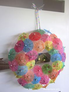 OMG!  I have a whole bag of these cocktail umbrella's.  I love this idea for summer  - in a screened in porch for the backyard or perfect near a pool!  Let me make one of these for you!  So sassy and bright!