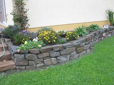 Landscaping Ideas For Small Yards | Walls made of stones and rocks as a continuation of the house. Tiny ...: