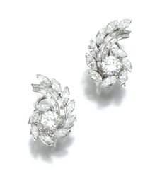 PAIR OF DIAMOND EARRINGS Each of swirl design set with marquise-shaped, baguette and brilliant-cut diamonds, post and clip fittings, case.