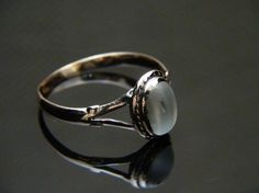 Vintage Rose Gold Moonstone Ring  I'm still looking to buy one of these love how simply elegent it is.