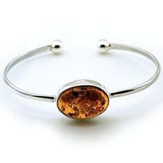 Cognac Amber and Silver Torque Bangle from Amber Zone silver jewellery