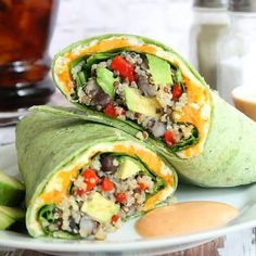 A delicious spinach tortilla filled with quinoa, veggies and avocado. Served with a chipotle aioli. #Vegan