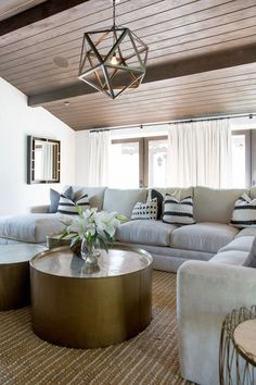 "On the media room: ""The priority for the media room in the Casita was to seat as many people as possible on an extra large plush sectional. Graphic pillows, brass coffee tables, and a geometric..."