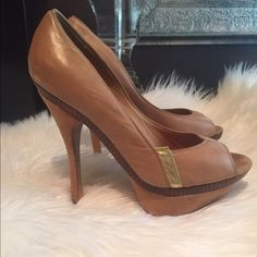 L.A.M.B. Platform pumps Gorgeous lamb platform pumps have been used but have a ton of where left and still look gorgeous. L.A.M.B. Shoes Heels