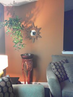 Accent wall. Paint color: Behr Gold plated. Antique wall art, woodstock bells fountain.