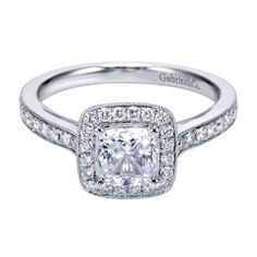 ER7527 is an attractive Pavé Set Cushion Halo Engagement ring set with Round Brilliant Diamonds down the shank and around the halo, and accented with Milgrain beading. This ring can set up to a 6.50mm Princess  Cut Diamond and has a total width of 2.00mm. Available in in Yellow Gold, White Gold, Rose Gold or Platinum.