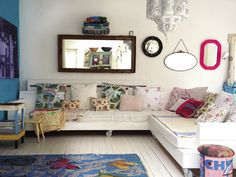 home of photographer debi treloar… love this eclectic living room. the moroccan lantern, the rolling sectional sofa, mirrors mirrors everywhere, and floors painted white always brightens up a room.