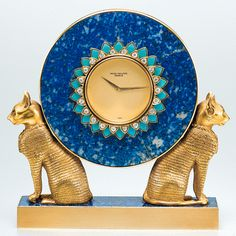 PATEK PHILIPPE, A FINE AND UNIQUE GOLD, LAPIS LAZULI, TURQUOISE AND DIAMOND SET MINIATURE EGYPTIAN-STYLE TABLE CLOCK 1978 REF 2011 MVT 1500401 CASE 2780492 - Sothebys