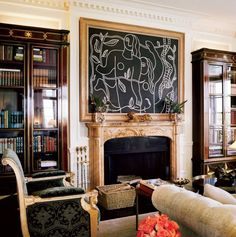 Designer Valentino's drawing room, where a Léger and a Ming-dynasty tiger grace a fireplace