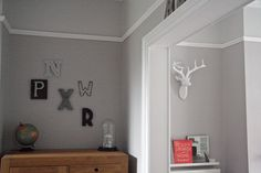 A mini room makeover including a reading corner with deer head and picture ledge and a collection of letters not he wall with a display dome. Hallway Colours, Room Colors, House Colors, Paint Colours, Hawthorne House, Hallway Paint, Bedroom Nook, Stair Makeover, Living Room Designs
