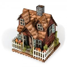 Sizzix - Bigz Die by Tim Holtz - Village Bungalow (requires Village Dwelling die)-Die measures x This dies creates the fence, windows and dormers to transform the Village Dwelling into a cottage bungallow. You will need the Village Dwelling Putz Houses, Village Houses, Bird Houses, Tim Holtz, Bungalow, Scrapbooking Dies, House Foundation, White Picket Fence, Glitter Houses