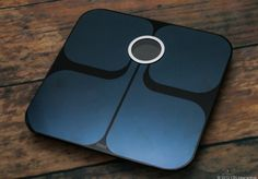 The Fitbit Aria Smart Scale not only uses WiFi to track your weight over time, it sends a tiny electrical charge through your body to compute body fat.