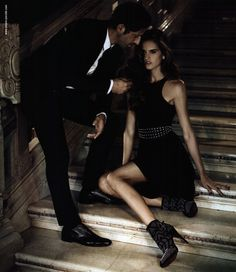 Gotta wonder what he's saying. Is he sitting her down to scold his submissive for her defiant behavior? :)