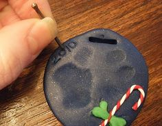 FAIL: DIY dog paw print ornament  We could barely make out E's paw on our ornament. We may try again though.