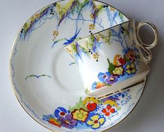 Art deco cup and saucer, with floral pattern and bird